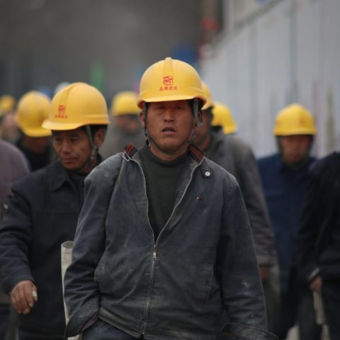 group-of-persons-wearing-yellow-safety-helmet-during-daytime-33266